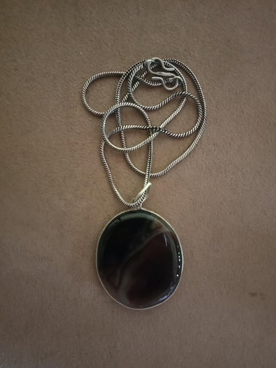 Brown gemstone pendant with chain