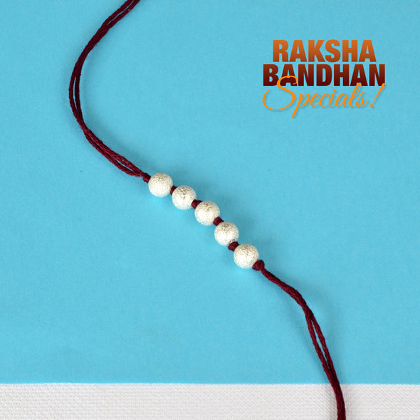 Knotted Silver Star Dust Ball Rakhi