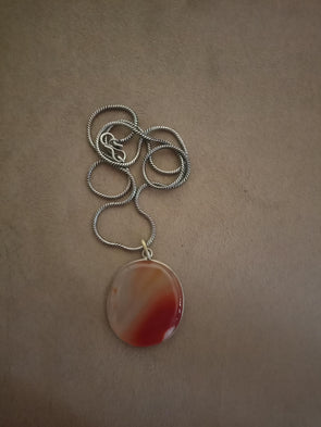 Orange pendant with chain