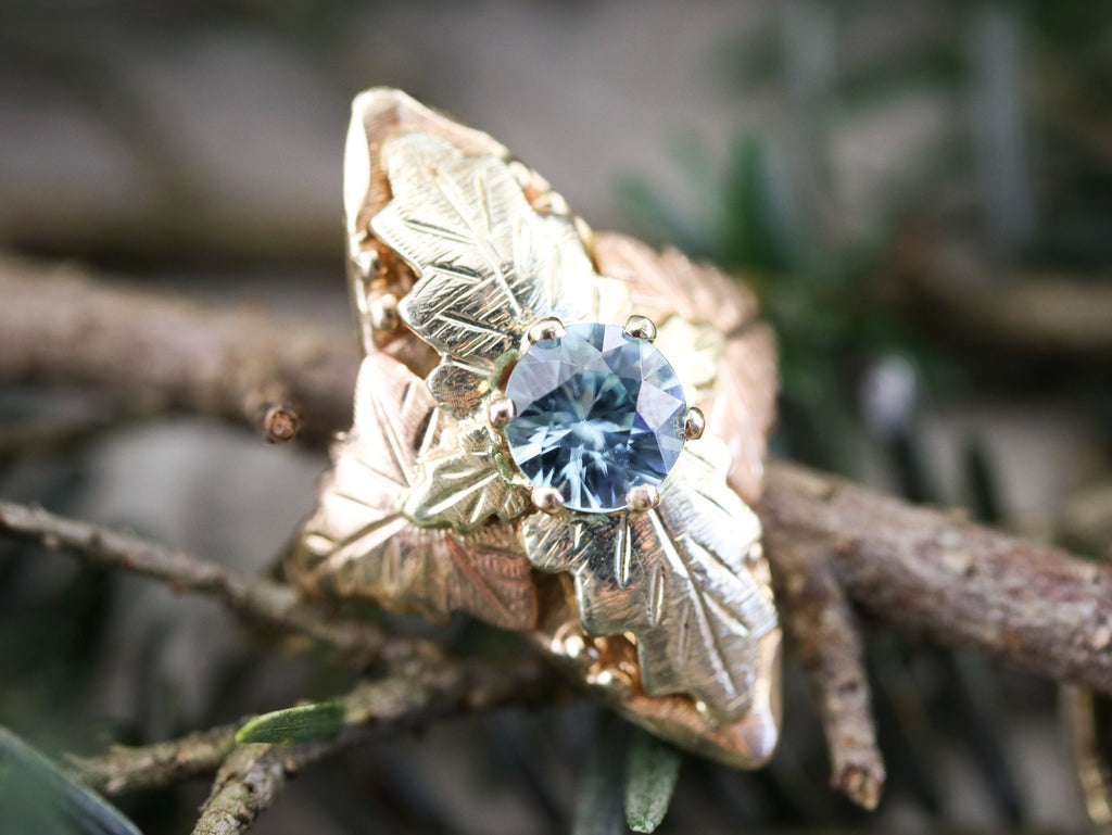 black hills gold blue zircon ring