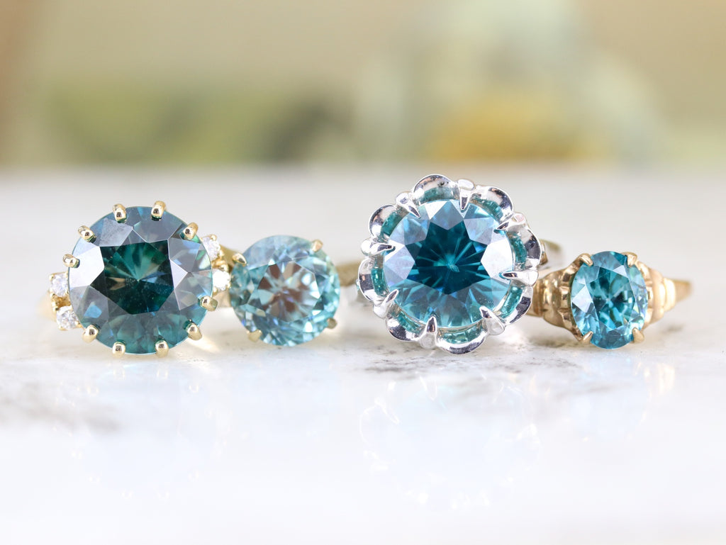 history and properties of blue zircon jewelry