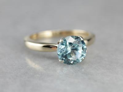 Timeless Blue Zircon Solitaire Ring in Yellow Gold