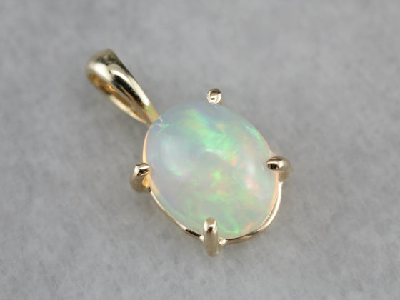 Oval Opal Pendant in Yellow Gold