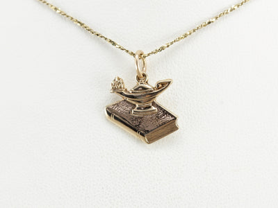 Gold Oil Lamp and Book Pendant