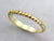 Twisting 18K Yellow Gold Band