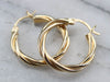 Twisting Yellow Gold Hoops