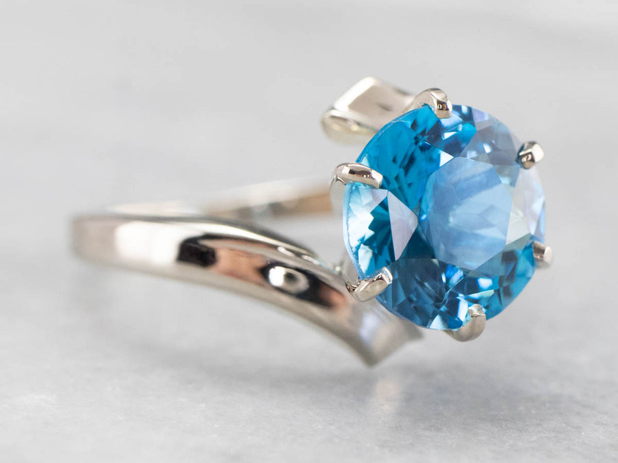 White Gold Blue Topaz Bypass Ring