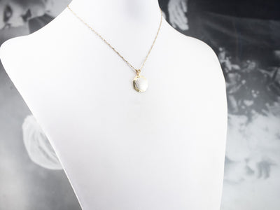 Platinum and Gold Textured Metal Pendant