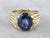Sapphire Gold Solitaire Ring with Rope Accents