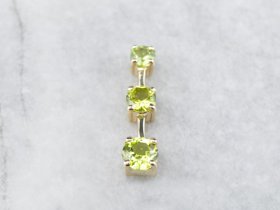 Graduated Three Stone Peridot Gold Pendant
