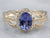 Tanzanite Diamond Halo Gold Ring