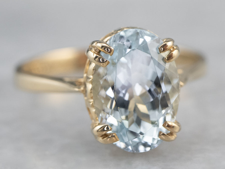 Oval Aquamarine Gold Solitaire Ring