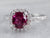 White Gold Ruby and Diamond Halo Ring