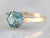 Yellow Gold Blue Zircon Solitaire Ring