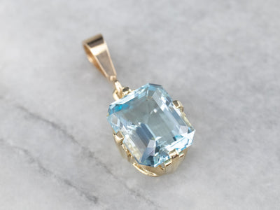 Timeless Blue Topaz Pendant in Yellow Gold
