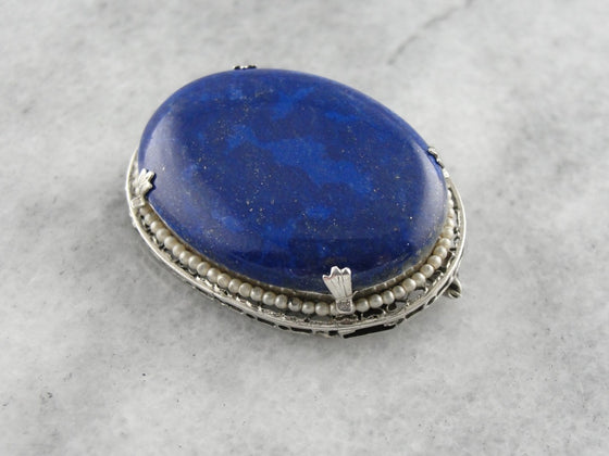 Art Deco Era Luxury: Lapis and Seed Pearl Brooch in Sterling Silver, Filigree Frame