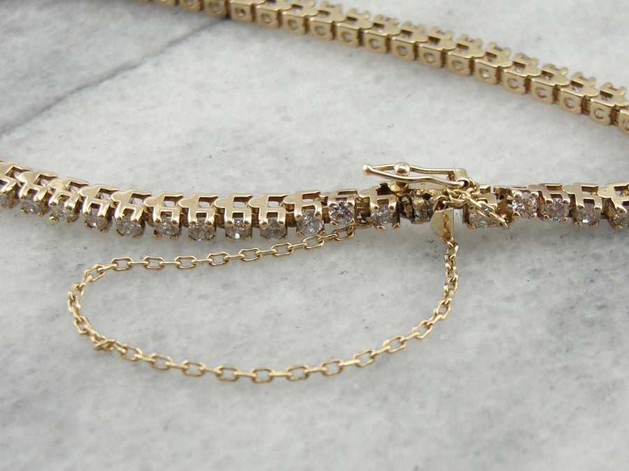 Classic Diamond Tennis Bracelet with Safety Chain in Yellow Gold