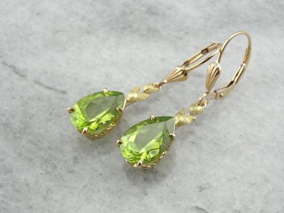 Perfect Green Drops: Peridot Drop Earrings with Leaf Motif Accent
