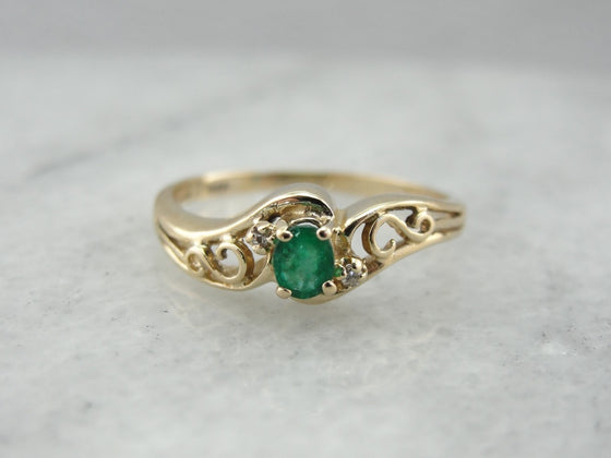 Emerald Ring with Swirled Bypass Setting in Yellow Gold