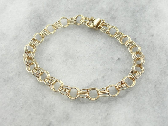 Classic Triple Link Charm Bracelet in Yellow Gold
