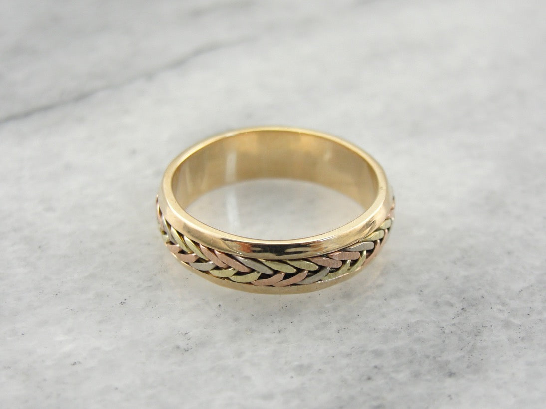 It is a picture of Vintage Multi Color Gold Wedding Band with Woven Center