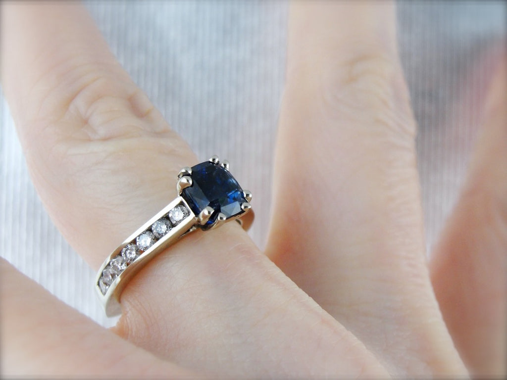 Cushion Cut Blue Sapphire Engagement Ring with Channel Set Diamonds in White Gold