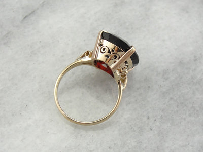 Huge Garnet Cocktail Ring with Ribbon Accented Shoulders in Yellow Gold