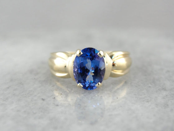Modern Tanzanite Cocktail Ring in Polished Yellow Gold, Shades of Blueberry