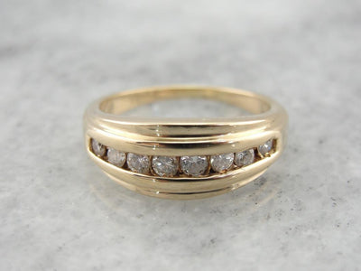 Tapering Diamonds: Mid Century Channel Set Diamond Band