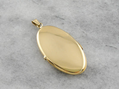 Vintage Yellow Gold Locket with Scrolling Floral Motif
