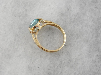 Sparkling Blue Zircon Solitaire in Modern Yellow Gold Mounting