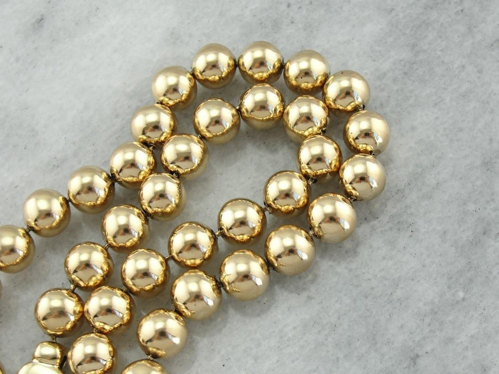 A Lifelong Statement: 18K Yellow Gold Beaded Necklace