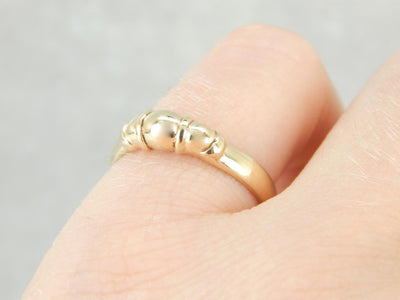 Sleek and Polished Domed Yellow Gold Band