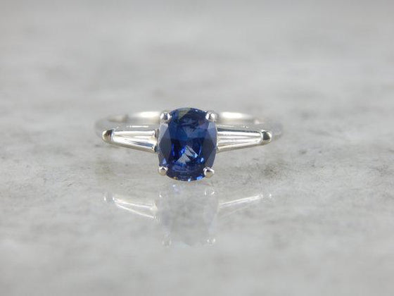 Refined White Gold and Sapphire Engagement Ring