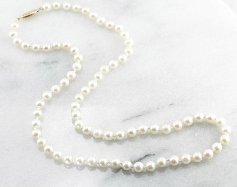 Timeless White Pearl Necklace with Gold Clasp