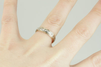 Wavelength: Pattern Wedding Band in Yellow and White Gold