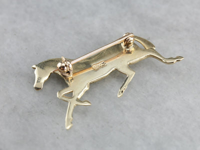 Golden Hooves: Galloping Horse Pin Crafted of Yellow Gold