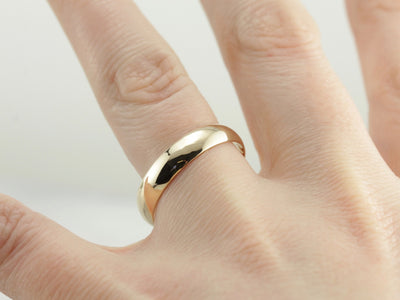 Smooth Low Dome Men's Wedding Band in Yellow Gold