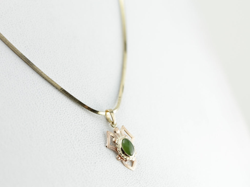 Dainty Jade Pendant with Abstract Geometric Design