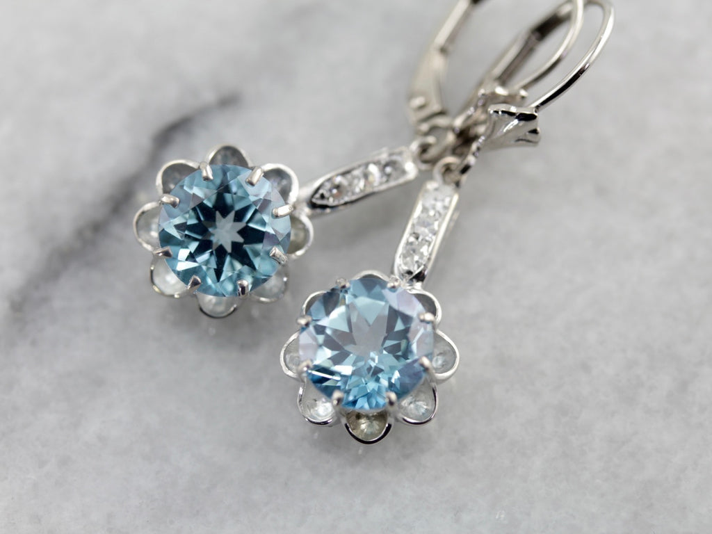 Icy Blue Topaz Drop Earrings with Single Cut Diamond Accents in White Gold