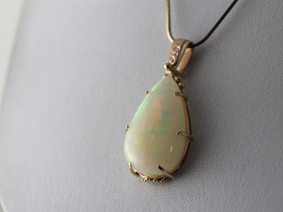 Huge Ethiopian Opal Pendant with Decorative Upcycled Bail