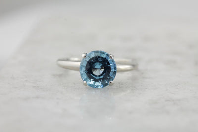 October Sky Engagement: Brilliant Round Blue Topaz Solitaire Ring