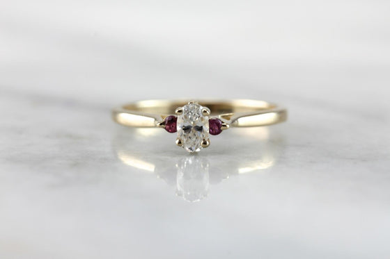 Stacks and Layers: Oval Diamond Engagement Ring with Ruby Details
