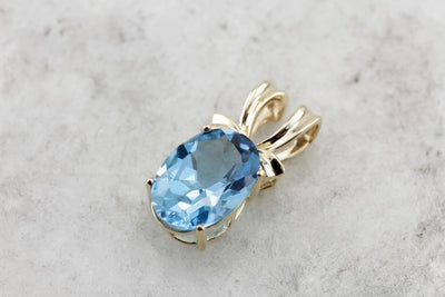 Brilliant Blue Topaz Pendant in Polished Yellow Gold