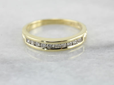 Channel Set Diamond Wedding Band in Polished Yellow Gold