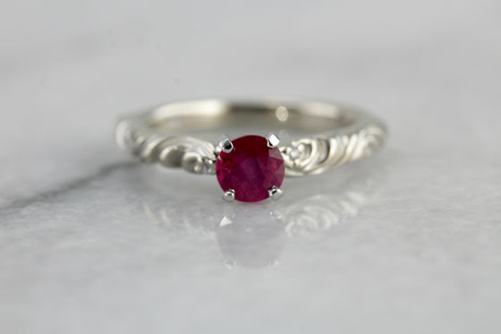 Sweet Scrolling Ruby Solitaire Ring in White Gold, Perfect for Engagement Ring or Any Occasion