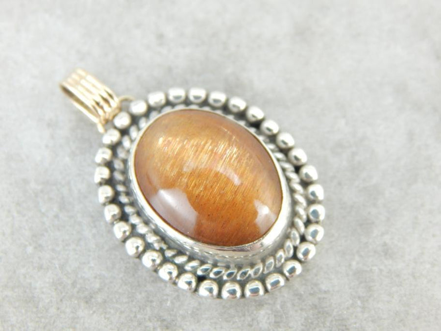 Glittering Orange Sunstone Pendant in Sterling and Gold Frame