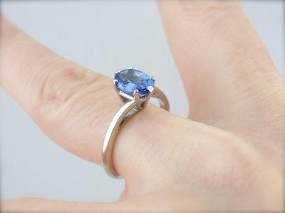 Twisting, Sleek Solitaire and Bright Tanzanite Ring