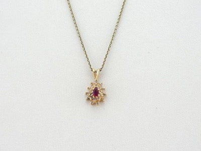 Ruby and Diamond Halo Pendant in Yellow Gold