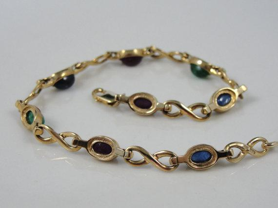 Unusual Cabochon Sapphire, Ruby and Emerald Bracelet in Fine Gold